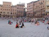 People relaxing on il Campo at dusk